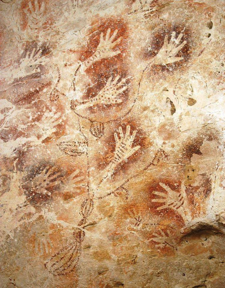Hand-stencil rock art from Gua Tewet, Borneo, thought to be over 10,000 years old. Photo by Luc-Henri Fage
